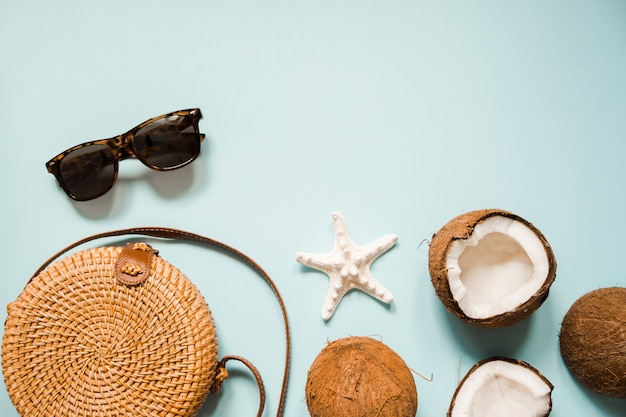 Flat lay with ripe coconuts on blue Premium Photo