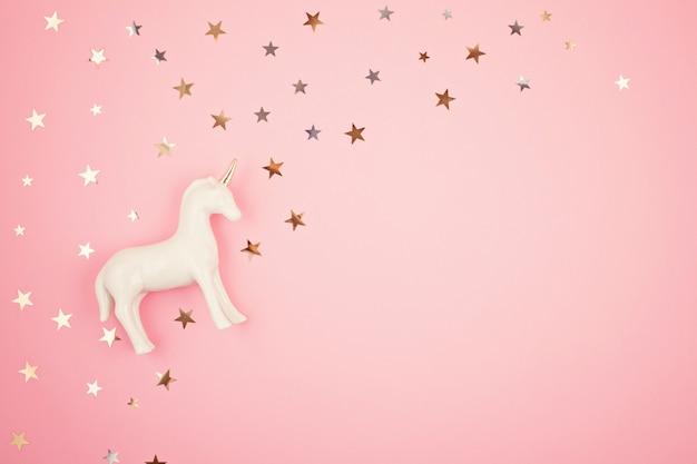 Flat lay with white unicorn and stars Premium Photo