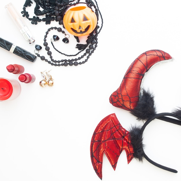 Flat lay woman's accesories for halloween party on white background Premium Photo