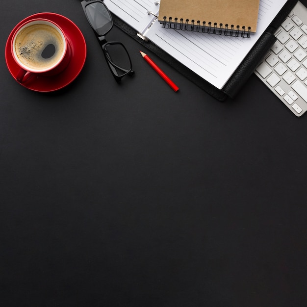 Flat lay of work desk with coffee cup and copy space Free Photo