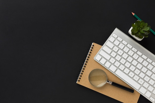 Flat lay of work desktop with notebook and keyboard Free Photo