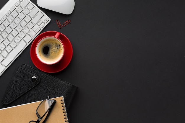Flat lay of work space with coffee cup and keyboard Free Photo