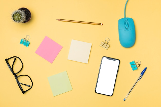 Flat lay workspace concept with yellow background Free Photo