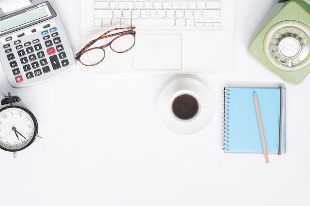 Flat Lay Of Workspace Desk With White Laptop Stationery