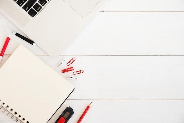Flat lay of workspace with notebook Free Photo