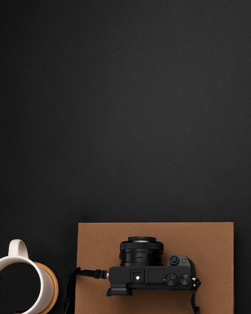 Flat lay of workstation with copy space and camera Free Photo