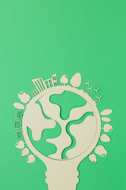 Flat lay world environment day wooden object with copy space Premium Photo