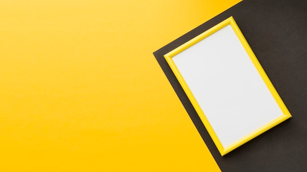 Flat lay of yellow frame with copy space Free Photo