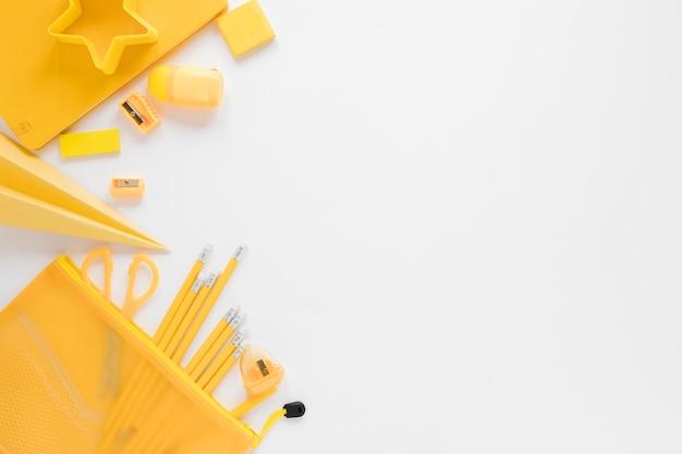 Flat lay of yellow school supplies Free Photo