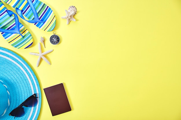 Flat lay yellow summer travel concept background Premium Photo