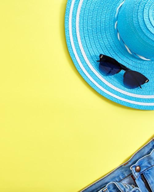 Flat lay yellow summer travel concept background Premium Photo