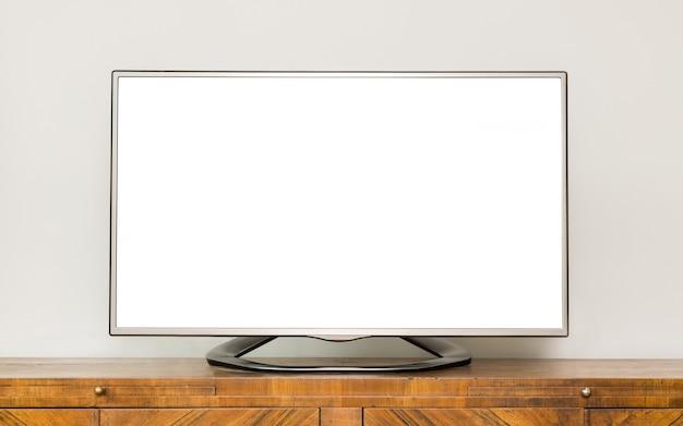거실의 갈색 나무 캐비닛에 평면 Lcd Tv. 프리미엄 사진