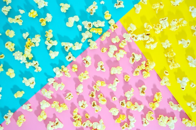 Flat of popcorn over colorful background Free Photo