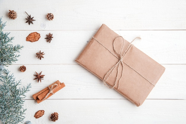 Flatlay. cinnamon,spruce branches and christmas gift Premium Photo