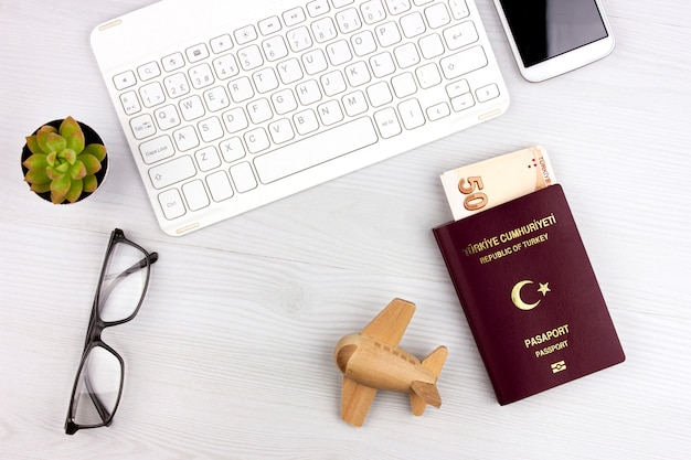 Premium Photo   Flatlay with turkish passport, plane and money