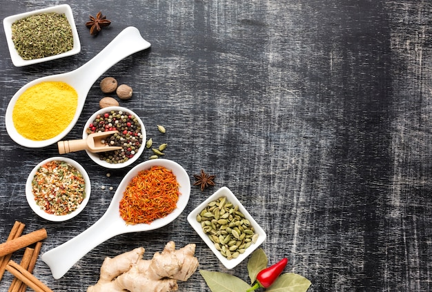 Flavored spices assortments on table Free Photo