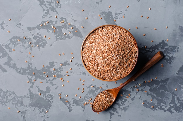 Flax seeds in wooden bowl Premium Photo