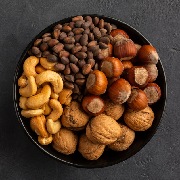 Flay lay of bowl with nuts Free Photo
