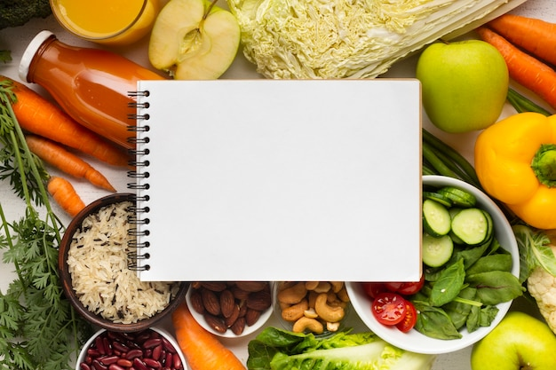 Flay lay of notebook mock-up on groceries Free Photo
