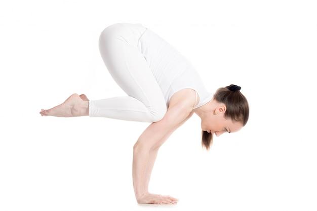Flexible woman doing an acrobatic posture Free Photo