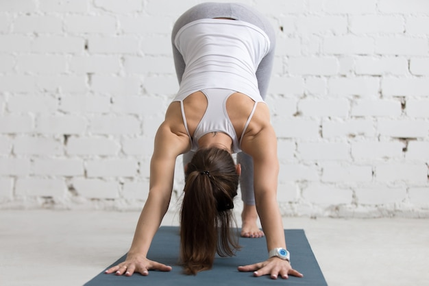 Flexible woman stretching her back and arms Free Photo