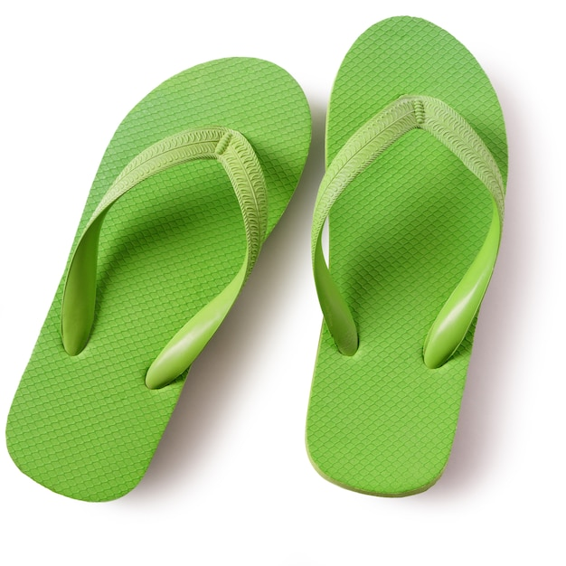 d80fb423c256 Flip flop beach shoes green isolated on white background Free Photo
