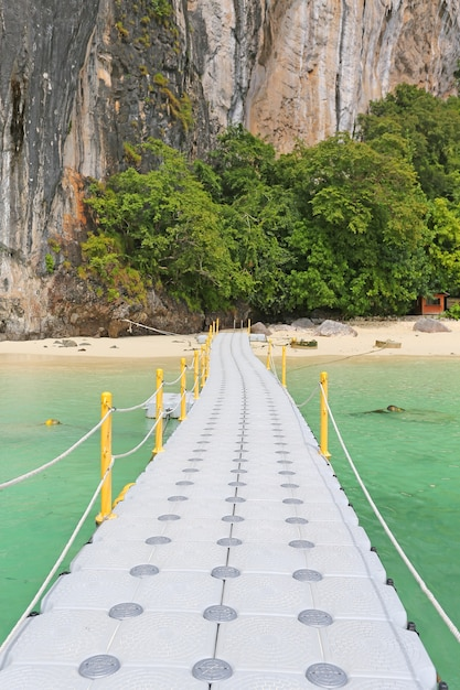 Floating pontoon footpath in the sea for go to the beach. Premium Photo