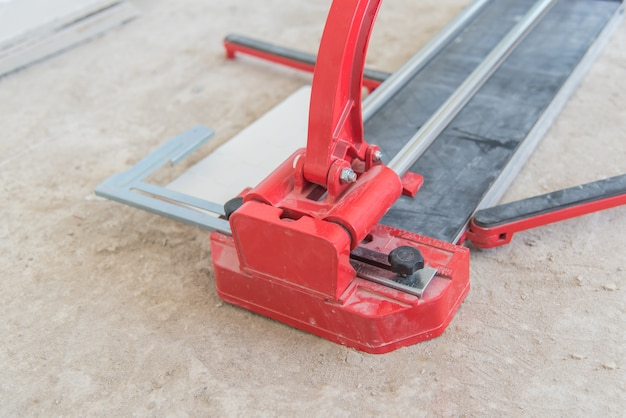 Floor Tile Cutting Equipment At Construction Site Photo Premium