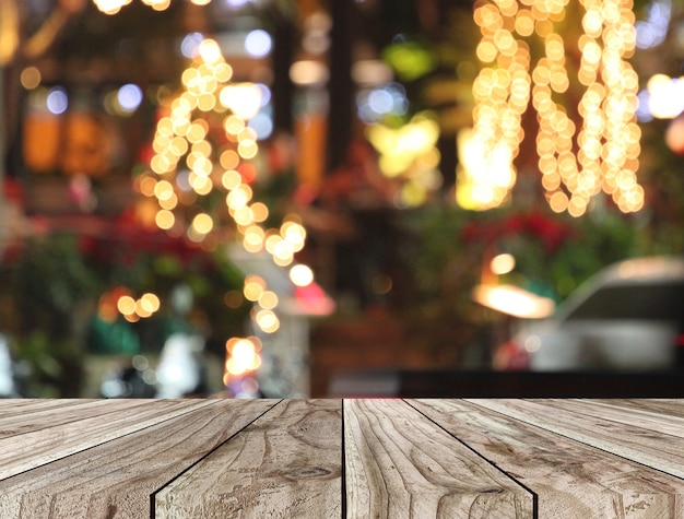 Floor of wooden table and christmas bokeh background. Premium Photo
