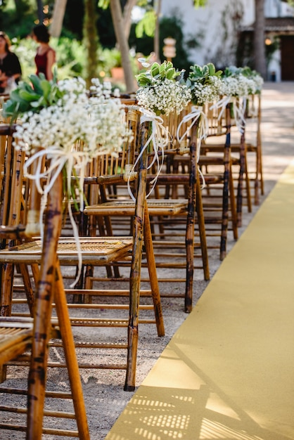 Floral arrangements for empty chairs for a wedding ceremony in spring Premium Photo