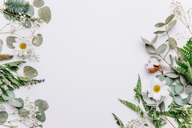 Floral background with leaves on sides Premium Photo