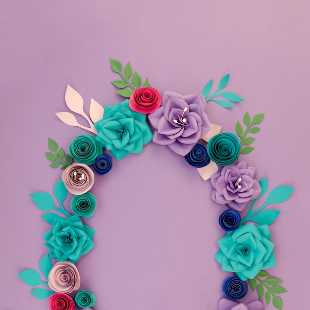 Floral circular frame on purple background Free Photo