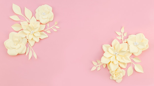 Floral frame on pink background Free Photo