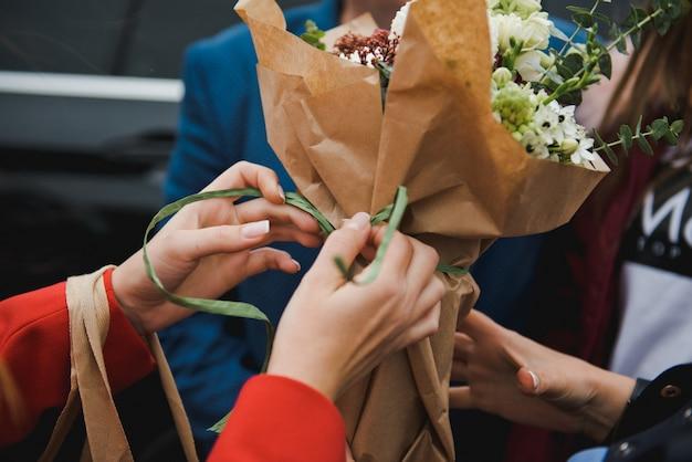 Florist makes a bouquet. florist girl collects a large beautiful bouquet Premium Photo
