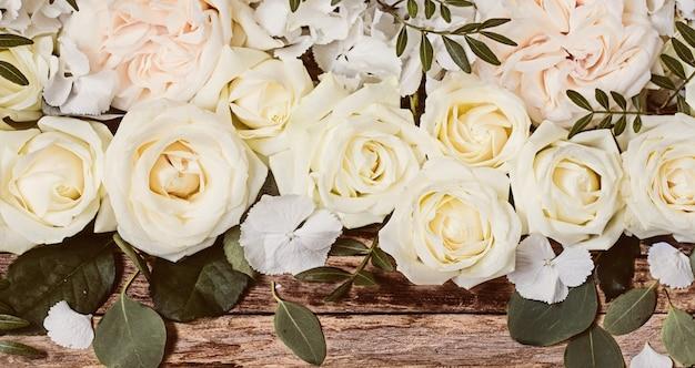 Flower arrangement on wooden surface Free Photo