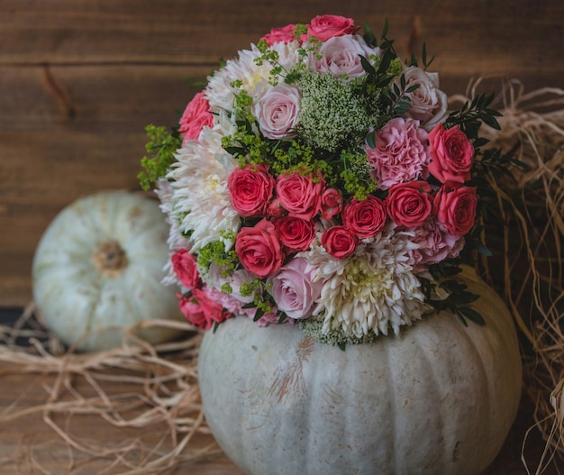 Flower bouquet put inside pumpkin ball Free Photo