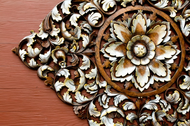 A flower carved in wood Free Photo