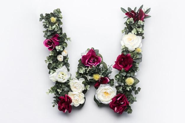 Flower letter w floral monogram Free Photo