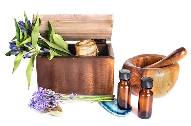 Flower, mortar and essential oils Premium Photo
