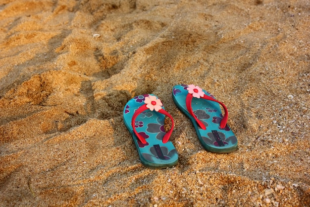 Flower pattren on bule sandals on beach. Premium Photo