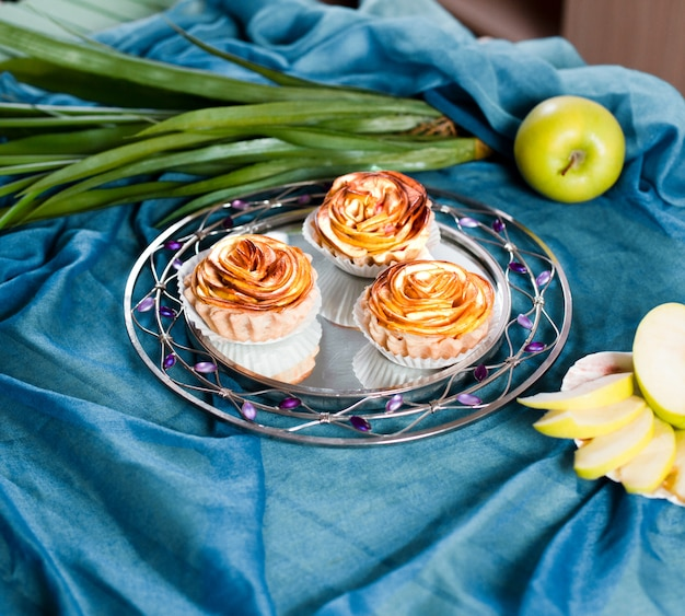 Flower shape apple sweet pies in the plate. Free Photo