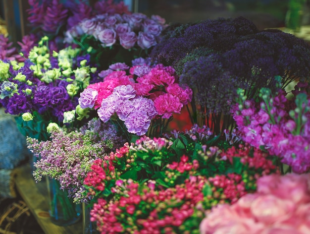 Flower shop stand with lots of varieties of flowers Free Photo