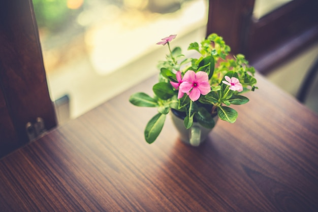 Flower vase on the table at the window Premium Photo