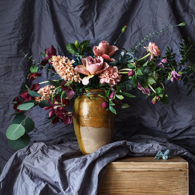 Flower in the vase on a table Free Photo