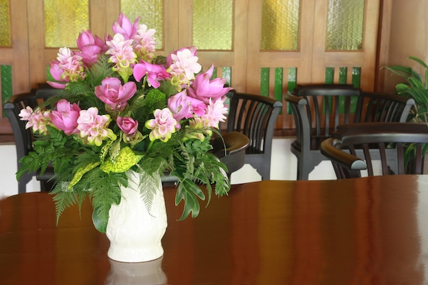 A flower vase on wood table Premium Photo