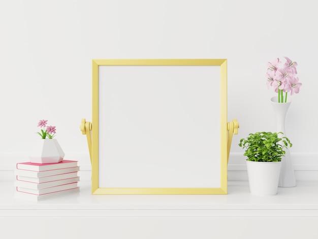 Желтый рамочный макет с вертикальной рамкой, пустой рамочный макет в новом интерьере с flowers.3d рендерингом Premium Фотографии