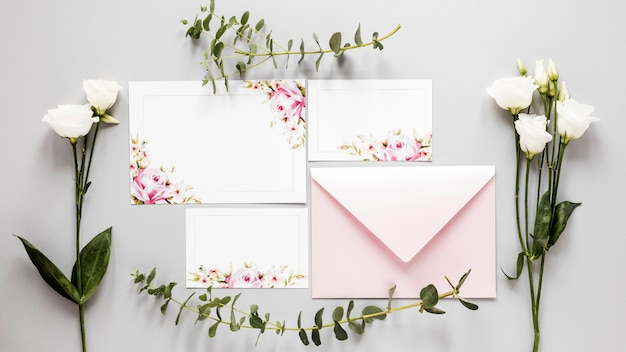 Flowers beside wedding invitation Free Photo
