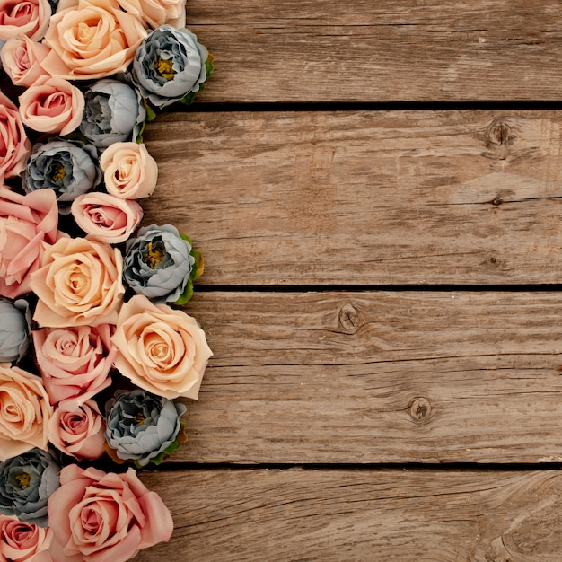 Flowers on brown wooden background Free Photo
