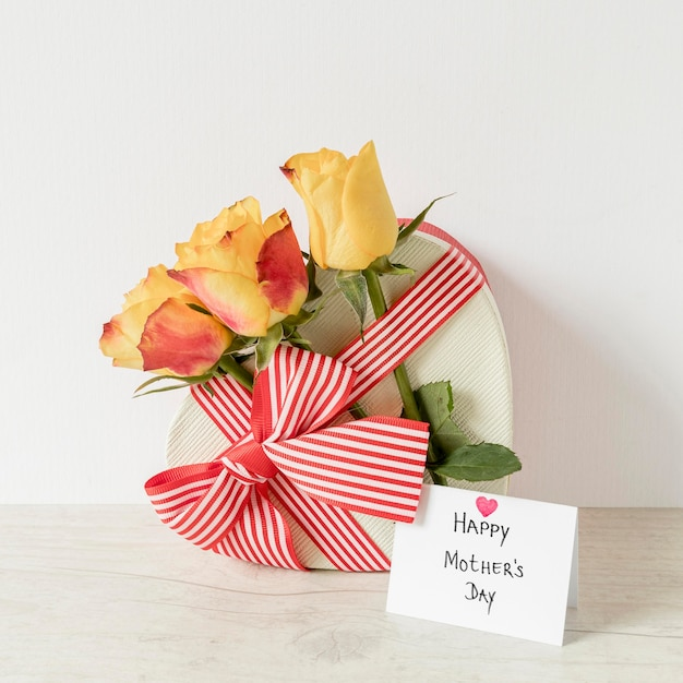 Flowers, card and gift for mother's day Free Photo