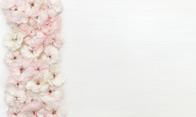 Flowers composition. border made of flowers, flatlay, copy space, top view, desk Premium Photo
